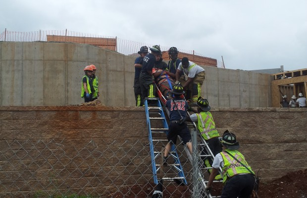 Firefighters Rescue Man At Construction Site
